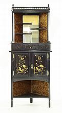 An Aesthetic ebonised corner cupboard, in the