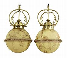 A pair of 'Art Nouveau' ceiling lights, each with
