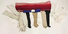 A collection of textiles,  including a quantity of gloves with some kid