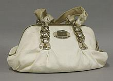 A Versace handbag,  cream leather with embossed Greek key decoration, g
