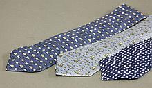 Three Hermès silk ties,  blue ground, printed with animal designs, peng