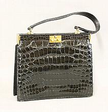 A lady's black leather 'Waldybag' handbag,  with embossed crocodile ext