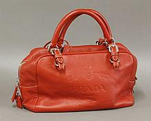 A Prada red leather handbag,  with embossed Prada Milano logo design, c