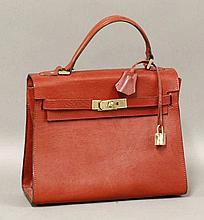 A Baronessa Franchetti red leather handbag,  in the Birkin style with p