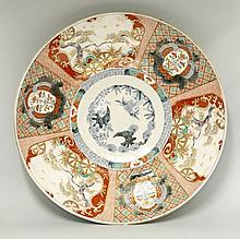 An Arita Dish, c.1870, painted in Imari style with