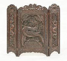 A three-fold hardwood screen, c.1920, carved in