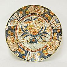 A large Arita Dish, c.1690, painted in the Imari
