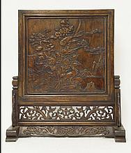 A carved table screen, decorated with pheasants