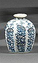 VASE À EAU en porcelaine et bleu de cobalt sous couverte, la panse octogonale à renflement médian et le petit col évasé, à décor de ...