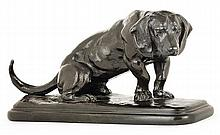 A patinated bronze seated basset hound by Antoine Louis Barye, signed. Posthumous cast. HAUT. 13 cm - LONG. 26,4 cm - PROF. 9,7 cm HEIG