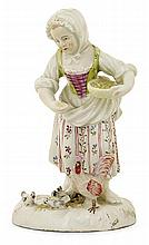 A Zurich porcelain figure of a peasant woman, 18th century. HAUT. 12 cm HEIGHT. 4 11/16 IN.