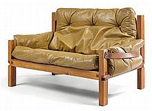 Pierre CHAPO (1927-1986) An elm, brown and gold leather two-seater sofa. Height. 28 3/8 in. - Length.?50 in. - Depth.?19 3/4 in.