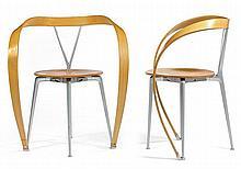 Andrea BRANZI (Né en 1938) & CASSINA (Éditeur) A pair of cast aluminum and ash plywood