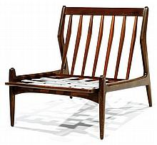 Ib KOFOD-LARSEN (1921-2003) & SELIG (Éditeur) A zoomorphic teak easy chair. Producer's stamp. Height. 26 3/4 in. - Width. 25 3/8 in. -