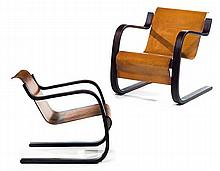 Alvar AALTO (1898-1976) A pair of cantilever mahogany tinted molded plywood