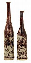 TRAVAIL ITALIEN A series of two enamelled stoneware bottle vases. Non identified signatures. Height. 9 5/8 IN. and 8 IN. Haut. 24,4 cm