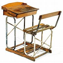 PERICLES (Éditeur) A steel and wooden school desk with integrated chair, circa 1950. Producer's stamp. Height. 29 1-8 in. - Width. 19 1