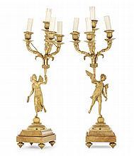 Paire de candélabres en bronze doré à décor d'ange à la corne d'abondance et à la couronne de laurier tenant chacun quatre bras de l...