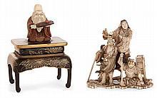 #LOT DE DEUX OKIMONO le premier, en ivoire, représentant une scène légendaire impliquant deux personnages en pied sur des nuées...