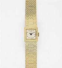 ETERNA ANNEES 50 Petite montre bracelet de dame en or jaune. Boîtier carré en accolade. Cadran argenté avec index appliqués. Mouveme...