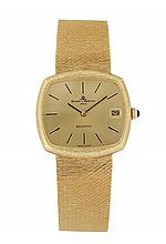 BAUME ET MERCIER BAUMATIC ANNEES 70 Montre bracelet en or jaune avec cadran