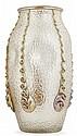 LOETZ Vase ovoïde en verre soufflé dans une résille, panse déformée d'enfoncements, décor rapporté à chaud de filets de verre ambré ...