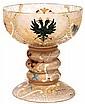 DAUM NANCY Calice parlant en verre translucide légèrement ambré à décor gravé à l'acide, représentant, dans des cartouches et des ré...