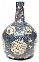 Henri CHAUMEIL (1877-1944) Vase sphérique en faïence, surmonté d'un long col cylindrique, décor d'inspiration chinoise présentant de...