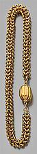 Collier en or jaune à maillons serpent terminés par un fermoir à côtes portant la mention