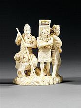OKIMONO en ivoire, représentant un sage assis sur un rocher en compagnie de deux oni en pied, l'un tenant un sceptre ruyi, l'autre, ...