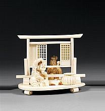 OKIMONO en ivoire, représentant Benten assis derrière une cloison coulissante pour épier Daikoku en train de déjeuner, un chat alléc...