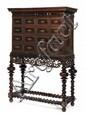 IMPORTANT CABINET en palissandre ouvrant par dix tiroirs sur quatre rangs, dont les façades sont entourées de guillochis et comportent