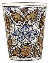 ÉMILE GALLÉ (1846-1904) A multicolored enamelled transparent glass cup. Enamelled signature under the base. Height. 3 1/2 in.