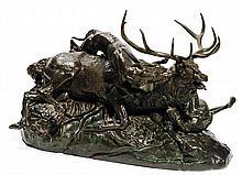 ANTOINE LOUIS BARYE (1795-1875) Cerf dix cors terrassé par deux lévriers Bronze cast with green patina