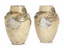 Ernest CARRIÈRE (1858-1908) Paire de vases en grès, à corps ovoïde et épaulement marqué, col tronconique, à décor en relief d'une mé...