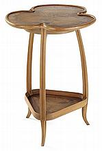 Louis MAJORELLE (1859-1926) A two-tier and three-legged ash pedestal table, tops inlaid with a marquetry design of foliage. Incised sig