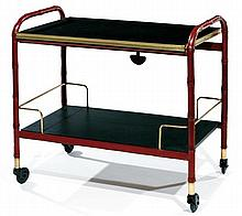 Jacques ADNET (1900-1984) A two-tier red leather and skai trolley, brass ornaments. Height. 30 1/8 in. - Width. 19 1/8 in. Lenght. 32 1