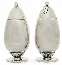 GEORG JENSEN (1870-1935) A set of ovoid silver salt shaker and pepper shaker, designed in 1931, produced between 1945 and 1951. Silvers