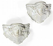 Vadim ANDROUSOV (1895-1975) A pair of plaster wall lamps, shaping three faces, designed in 1937. Height. 6 3/4 in. - Width. 9 7/8 in. -