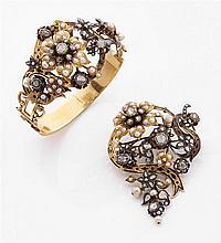 Demi-parure  composée d'un bracelet et d'une broche en or jaune à décor d'émail noir