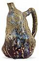 Eugène LION (1867-1945) Pichet coloquinte en grès, corps piriforme cabossé à décor de coulures sang de boeuf violettes sur fond beig...