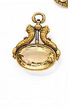 Années 1830 Clef de montre à chaton tournant ornée d'une grande citrine. Monture en or rose 18K à décor de cornes d'abondance. Poids...