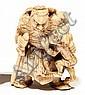 NETSUKE en os sculpté, représentant Choki tenant un oni suppliant par la peau du dos