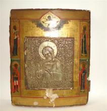 Saint Jean-Baptiste encadré de quatre autres saints Icône, tempera sur bois et laiton. (Manques, usures.) Russie, XIXe siècle. A 19t...