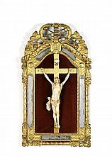 ENTOURAGE DE PIERRE SIMON JAiLLOT (1631-1681) Christ en croix en ivoire surmonté d'un crâne dans un encadrement à pareclose en bois ...