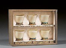 Four jade beakers, China, 20th century. H. 1 9/16 in.