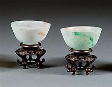 A pair of jadeite cups, China. H. 1 3/16 in. - D. 2 in.