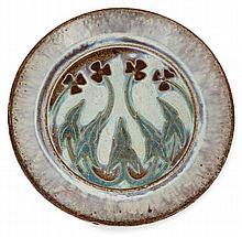 Alexandre BIGOT (1862-1927) A circular enamelled stoneware plate
