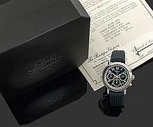 CHOPARD. CHRONOGRAPHE MILLE MIGLIA. ÉDITION ELTON JOHN AIDS FOUNDATION SERIE LIMITEE A 2000 EX. VENDUE EN JUIN 2002. Montre bracelet...
