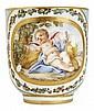 SÈVRES Gobelet Calabre en porcelaine tendre à décor polychrome d'un amour tenant une serpe assis contre une gerbe de blé dans un pay...